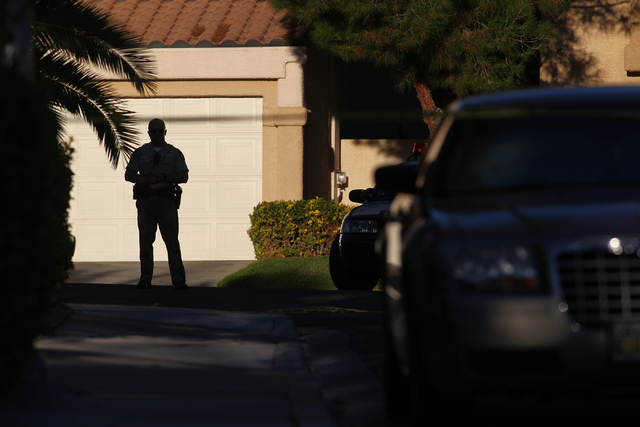 A Las Vegas police officer stands on the 1600 block of Broadmere Street on Monday, Sept. 22, 2014, where a fatal shooting occurred, near Hualapai Way and Charleston Boulevard, in Las Vegas around  ...