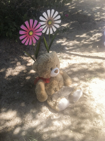 A teddy bear and flowers were left near the lot at Chaparral and Country Club drives in Bullhead City, Arizona, where the body believed to be 8-year-old Isabella Grogan-Cannella was found Wednesda ...