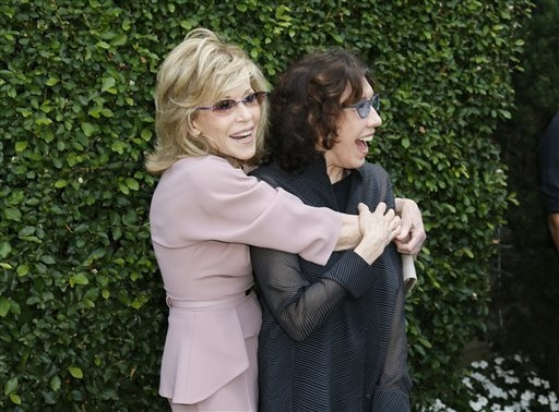 Actress and event host Jane Fonda, left, and actress Lily Tomlin embrace at The Rape Foundation's Annual Brunch at Greenacres on Sunday, Sept. 28, 2014, in Beverly Hills, Calif. (Photo by Danny Mo ...