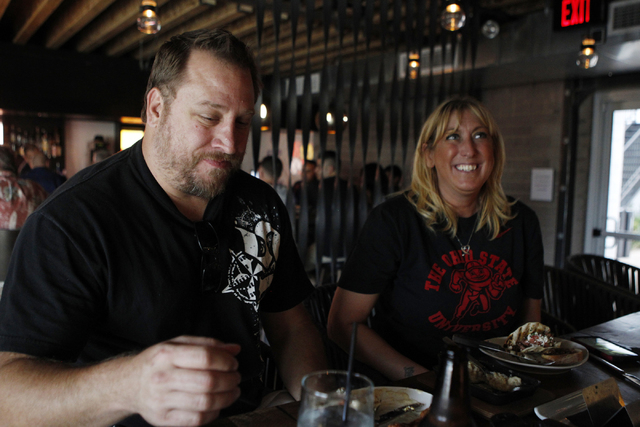 Jeff Urbanski, left, and his wife Shelley dine at Carson Kitchen restaurant, 124 S. Sixth St. in Las Vegas, during dinner service Saturday, Aug. 30, 2014. (Erik Verduzco/Las Vegas Review-Journal)
