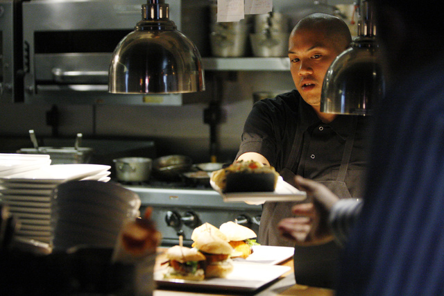 Food is seen handled out of the kitchen during dinner service at Carson Kitchen restaurant, 124 S. Sixth St. in Las Vegas, is seen on Saturday, Aug. 30, 2014. (Erik Verduzco/Las Vegas Review-Journal)