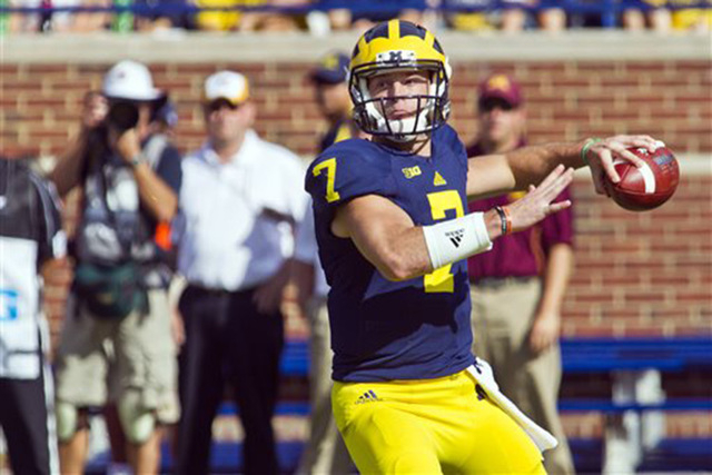 Michigan quarterback Shane Morris (7) throws a pass in the first quarter of an NCAA college football game against Minnesota in Ann Arbor, Mich., Saturday, Sept. 27, 2014. (AP Photo/Tony Ding)