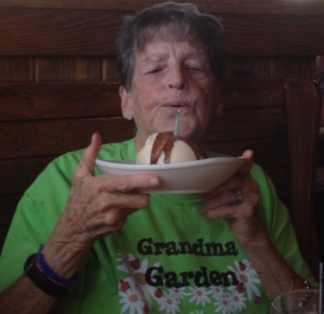 Sue Kam blows out the candle on her dessert Sept. 9 at the family celebration of her 78th birthday in Las Vegas. Kam was born premature and was not expected to live, so her father placed her in th ...