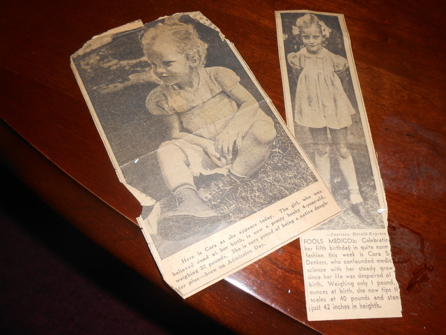 Yellowed newspaper clippings from the 1930s are seen Aug. 26 in Sue Kam's home. Her unexpected birth saw her father place her in a cigar box and into the oven to keep her warm until an ambulance c ...