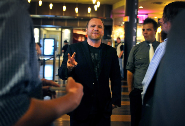 Club promoter Chris Hornak informs one of his groups of guests some of the dos and don'ts before they enter the Ghostbar at the Palms hotel-casino on Friday, Aug. 29, 2014. (David Becker/Las Vegas ...