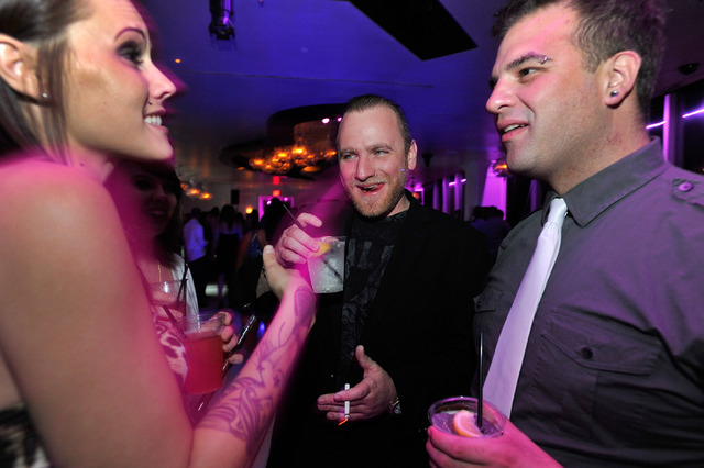 Club promoter Chris Hornak, center, shares a drink with one of his employees, Brittany Gilmore, left, and tour manager Ryan Fockler inside the Ghostbar at the Palms hotel-casino on Friday, Aug. 29 ...