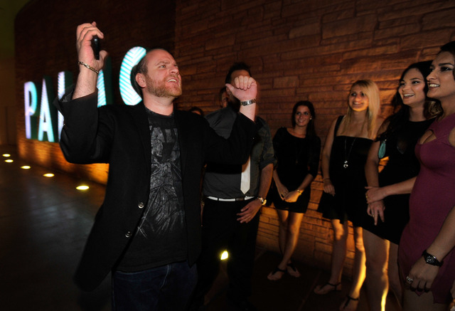 Club promoter Chris Hornak, left, shares with a group of 50 guests, the evening activities as they arrive at the Palms hotel-casino on Friday, Aug. 29, 2014. (David Becker/Las Vegas Review-Journal)