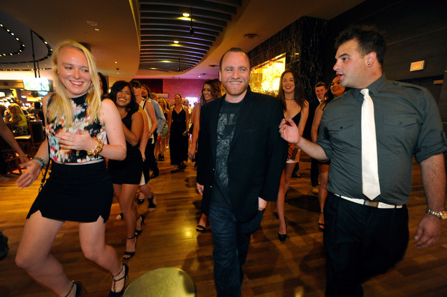 Club promoter Chris Hornak, center, along with tour manager Ryan Fockler, right, leads a group of 50 guests, including Danielle Clark of Australia, to the Ghostbar at the Palms hotel-casino on Fri ...