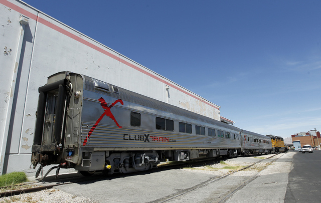 Union Pacific removes a pair of Club X Train cars from the Las Vegas Review-Journal's parking lot near the intersection of MLK Blvd. and Bonanza Rd. in Las Vegas on Thursday, July 24, 2014. (Jason ...