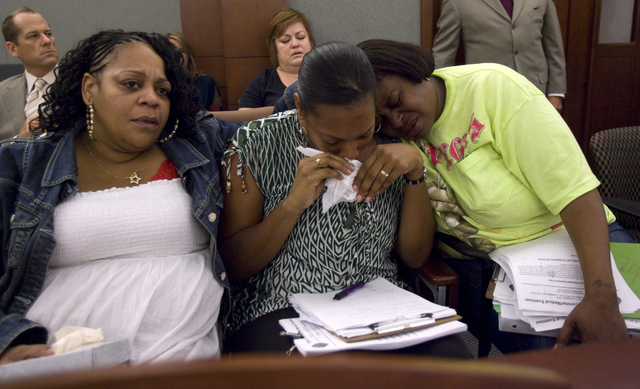 RJ FILE*** K.M. CANNON/LAS VEGAS REVIEW-JOURNAL Family members of slain suspect Trevon Cole, from left, mother Nichelle Bratton, aunt Kimeryn Williams and aunt Tisha Bell comfort each other as the ...