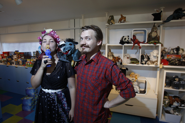 Lizzy Newsome, left,  and her husband Trevor Yopp, co-owners of Kappa Toys, pose for a portrait at their shop at the Container Park in Las Vegas Thursday, Aug. 28, 2014. Kappa Toys is one of three ...