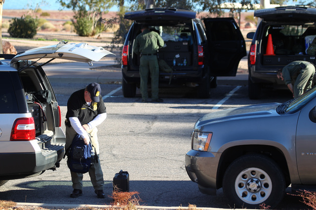 Law enforcement officials prepare equipment at the Boulder Beach Ranger Station on Dec. 8, 2011. Five people were killed in a sightseeing helicopter crash. (JEFF SCHEID/LAS VEGAS REVIEW-JOURNAL FILE)