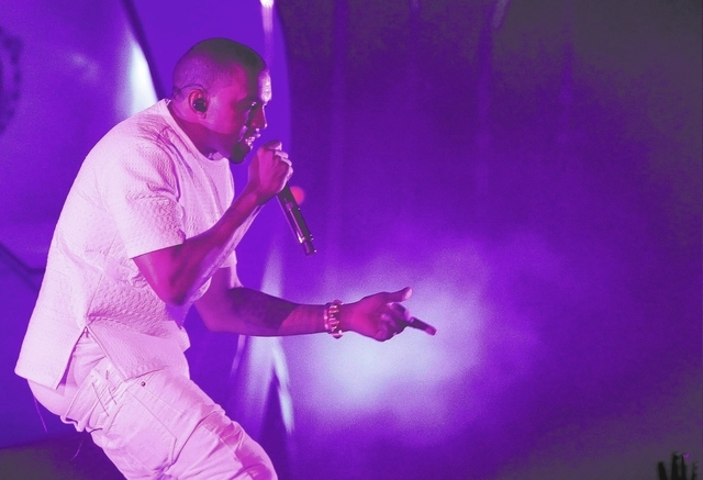 In this July 1, 2012 file photo, Kanye West -- who is West is scheduled to perform at the Life Is Beautiful music and food festival -- performs at the BET Awards in Los Angeles. (Photo by Matt Say ...