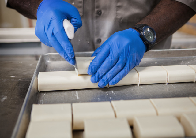 Plant manager Aaron Weatherly cuts new bars of soap at Global Soap Project at 3917 Lone Mountain Road in North Las Vegas as seen on Friday, Sept. 6, 2014. The nonprofit takes used bars of soap fro ...
