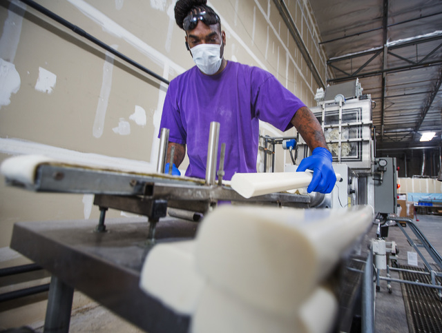 Desi Coleman stacks new bars of soap at Global Soap Project at 3917 Lone Mountain Road in North Las Vegas as seen on Friday, Sept. 6, 2014. The nonprofit takes used bars of soap from local resorts ...