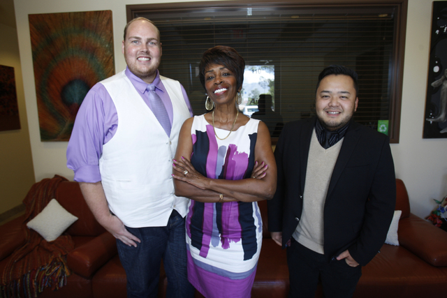 Mya Reyes, president of the Las Vegas Gay Visitors Bureau, center, poses a portrait with her employees Matthew Engh, left, and Donovan Kaneshiro at her office in Las Vegas Wednesday, Sept. 17, 201 ...