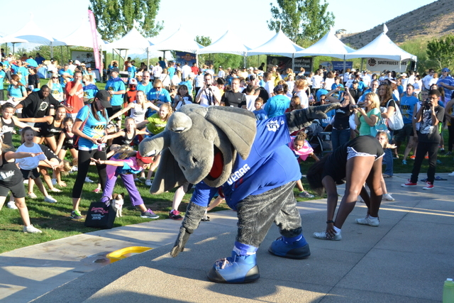 Courtesy photo Pre-Race Warm-Up with Cosmo-LV51s mascot Cosmo, the Las Vegas 51s' mascot, helps participants warm up for today's Candlelighters race and walk. This morning's activities are a ...