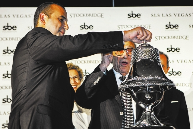 Sam Nazarian, left, CEO of SBE Entertainment,  and his father Yonnes during the ceremonial ringing of the bell at  SLS Las Vegas  on Friday Aug. 22, 2014. The $415 million  development on the corn ...