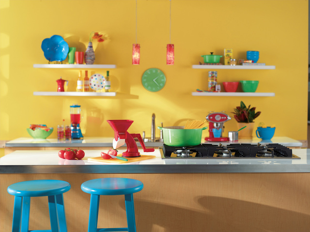 In this colorful kitchen the clock is the centerpiece of activity and color. (Courtesy, Sherwin-Williams)