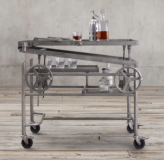 """Carts, such as the French cranklift bar cart, were brought back into style with the help of the television show """"Mad Men."""" (Courtesy, Restoration Hardware)"""