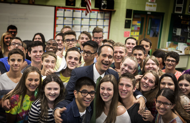 Former Green Valley High School principal Jeff Horn visits with choir students at the school at 460 Arroyo Grande Boulevard on Wednesday, Aug. 27,2014.. Horn spent 23 years as a teacher and admini ...