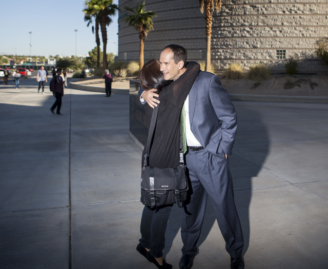 Former Green Valley High School principal Jeff Horn hugs River Galvez in front of the school at 460 Arroyo Grande Boulevard on Wednesday, Aug. 27,2014. (Jeff Scheid/Las Vegas Review-Journal)
