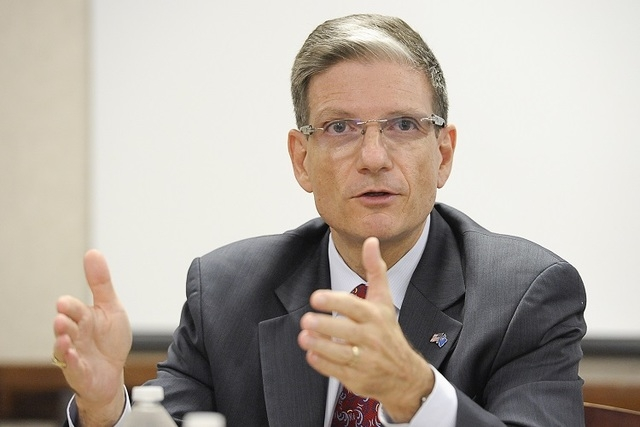 U.S. Rep. Joe Heck, R-Nev., speaks to the Las Vegas Review-Journal editorial board on Wednesday, Aug.13, 2014. Heck draws attention in the House for his Army Reserve promotion to brigadier general ...