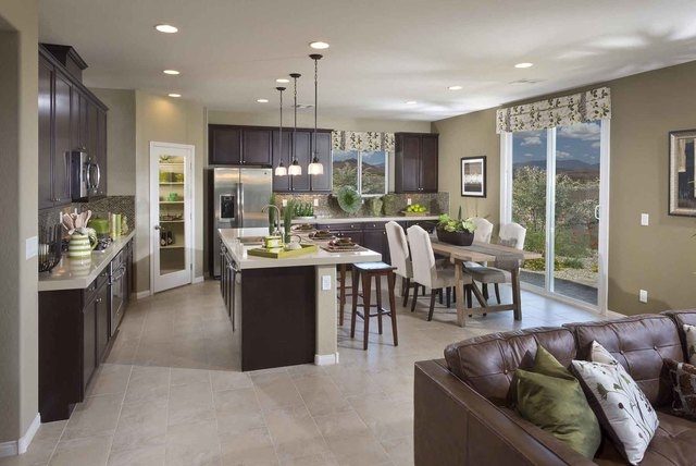 Courtesy photo Pictured is the front exterior, kitchen and spacious rooftop deck of the Sierra model home at Ryland's Tacinga Ridge neighborhood in Mountain's Edge. The Sierra is a 2,620 squar ...