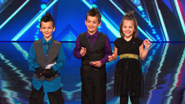 """Henderson triplets, from left, Phoenix, Dominic and Lyric Evans perform as Dom the Bom's Triple Threat on NBC's """"America's Got Talent."""" (Special to View)"""
