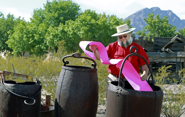 "Mark R. Hall-Patton, Museums Administrator for the Clark County Museums, poses with old ore mining buckets Friday Aug. 12, 2011. Hall-Patton is set to join ""Pawn Stars"" regulars Rebecca Romney, Br ..."