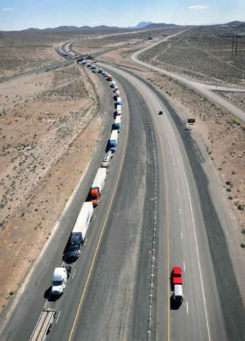 Traffic is backed up along the northbound side of Interstate 15 for several miles on Tuesday, Sept. 9, 2014. Highway officials are rerouting all vehicle traffic to US Highway 93 do to highway dama ...