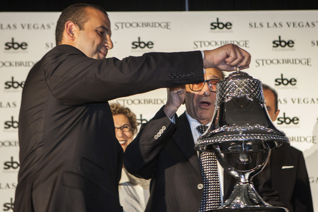 Sam Nazarian, left, CEO of SBE Entertainment,  and his father Yonnes during the ceremonial ringing of the bell at  SLS Las Vegas  on Friday Aug. 22, 2014. (Jeff Scheid/Las Vegas Review-Journal)