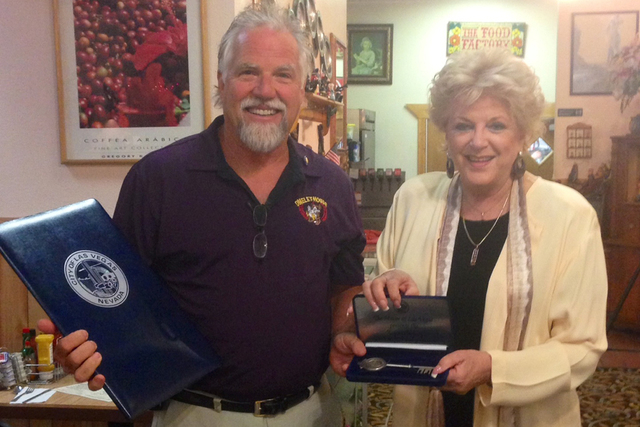 Kevin Mills, owner of the Omelet House, poses with City of Las Vegas Mayor Carolyn Goodman after receiving a key to the city at his restaurant on Friday, Sept. 12. (Courtesy, Christina R. Gupana)