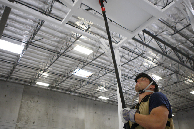 Shane Gammon, Candidate Physical Ability Test proctor, demonstrates how to use a pike pole in a exercise during a media CPAT course demonstration at their facility in Las Vegas Thursday, Sept. 11, ...