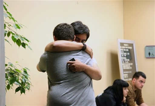 Unidentified relatives and friends of Bell Gardens mayor Daniel Crespo, grieve inside the city's police station in Bell Gardens, Calif., Tuesday, Sept. 30, 2014. Authorities say the mayor of Bell  ...