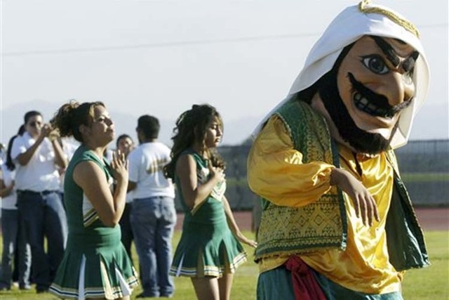 "Coachella Valley High School's mascot, ""Arab,"" dances to the band during a pep rally at the school in Thermal, Calif. The hook-nosed, snarling mascot who wears a head scarf did not appear at Coach ..."