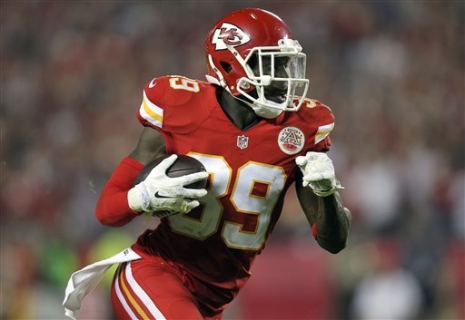 Kansas City Chiefs free safety Husain Abdullah carries the ball after intercepting a pass and running it back 39 yards for a touchdown during the fourth quarter of an NFL football game against the ...
