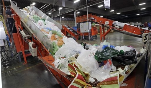 FILE-This Friday, Jan. 24, 2014 file photo conveyors carry mixed plastic into a device that will shred recycle them at a plastics recycling plant in Vernon, Calif. Gov. Jerry Brown has signed legi ...
