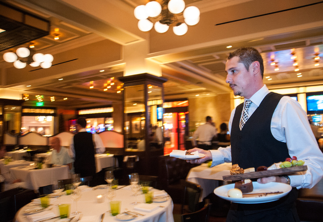 Server Thierry Euesque delivers plates of dessert to his customers at db Brasserie restaurant inside The Venetian in Las Vegas on Saturday Sept. 6, 2014. (Martin S. Fuentes/Las Vegas Review-Journal)