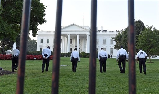 Uniformed Secret Service officers walk along the lawn on the North side of the White House in Washington, Saturday, Sept. 20, 2014. The Secret Service is coming under intense scrutiny after a man  ...
