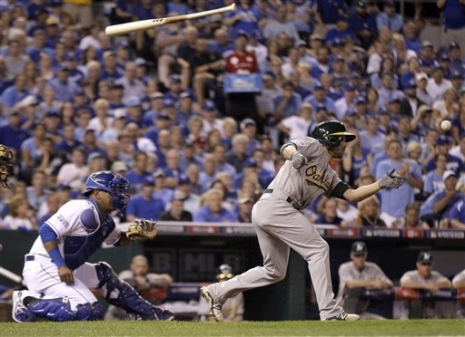 Oakland Athletics' Sam Fuld loses his bat as he takes a swing during the sixth inning of the AL wild-card playoff baseball game against the Kansas City Royals on Tuesday, Sept. 30, 2014, in Kansas ...