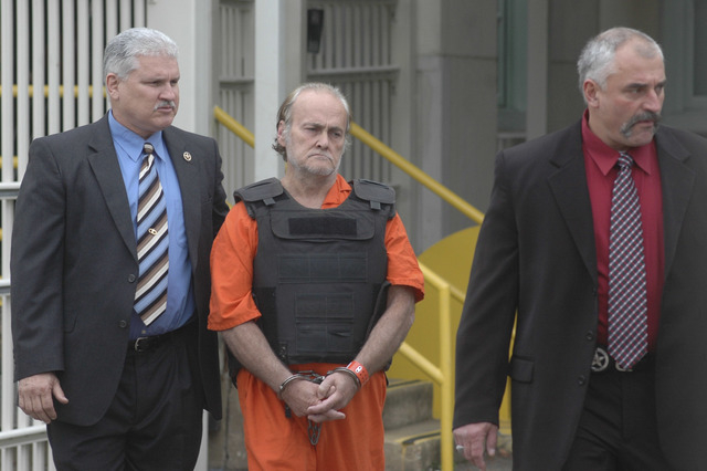 U.S. Marshalls escort Thomas Steven Sanders, right, out of the U.S. District Courthouse in Alexandria, La. after a detention hearing on Friday, November 19, 2010. (AP Photo/The Town Talk, Tia Owen ...