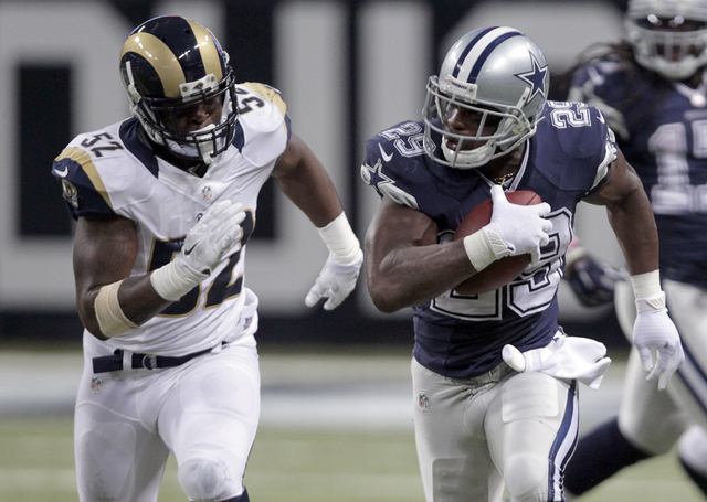 Dallas Cowboys running back DeMarco Murray, right, runs for a 44-yard gain as St. Louis Rams linebacker Alec Ogletree gives chase during the third quarter of an NFL football game Sunday, Sept. 21, ...