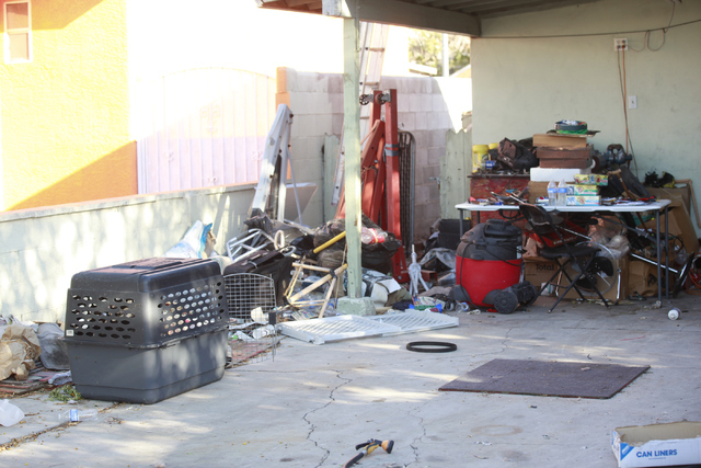 The front yard of a home where41 dogs died as the result of a fire Sunday night is seen Monday, Sept. 29, 2014, in the 2600 block of Stanley Avenue, near Eastern and Owens avenues in North Las Veg ...