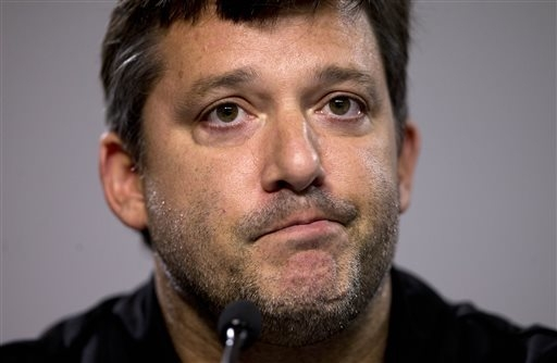 FILE - In this Aug. 29, 2014, file photo, NASCAR auto racing driver Tony Stewart reads a statement during a news conference at Atlanta Motor Speedway in Hampton, Ga. An upstate New York grand jury ...
