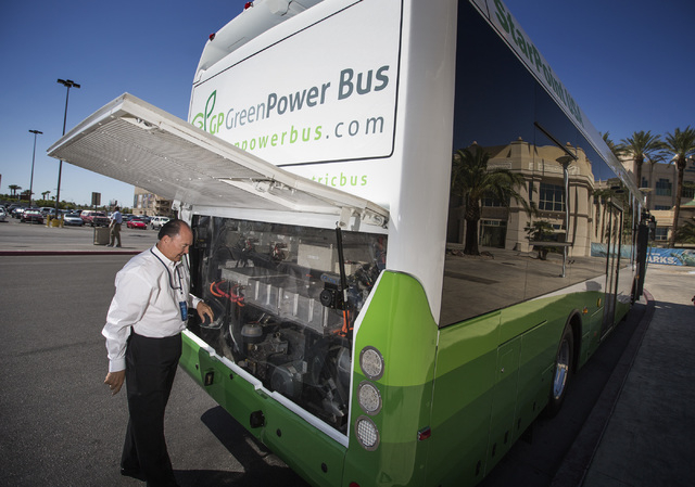 Ben Rainwater, president & CEO of BRAC Global Automotive Inc.,  shows the power system of their new EV350 all electric transit bus during National Clean Energy Summit 7.0: Partnership & Progress a ...