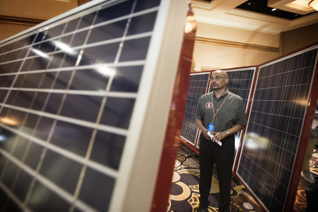 Madison Burnett, training director of the Electrical Apprenticeship Training Committee of Southern Nevada,  stands around solar panels during National Clean Energy Summit 7.0: Partnership & Progre ...