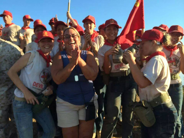 Marie Tomao and several of the Southern Nevada Devil Pups celebrate reaching the top of Old Smokey at Camp Pendleton in San Diego County, Calif., July 31. (Special to View)