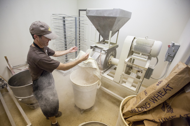 Great Harvest Bread franchisee Marcus Stewart uses a stone mill for flour at the bakery, 4800 E. Bonanza Road. (Chase Stevens/View)