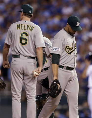 Oakland Athletics starting pitcher Jon Lester, right, walks off the field after being removed by manager Bob Melvin during the eighth inning of the AL wild-card playoff baseball game against the K ...